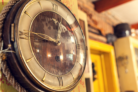 Cacak, Serbia - December 06, 2014: Old retro clock on the wall, as decorative detail inside Serbian restaurant.