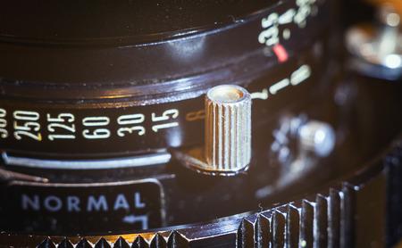 lens unit: Details of an old lens for large format cameras. Shutter speed adjustments.