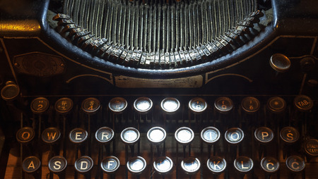 fingering: Details of an old typewriting machine, retro style with dusty metal and buttons. Stock Photo
