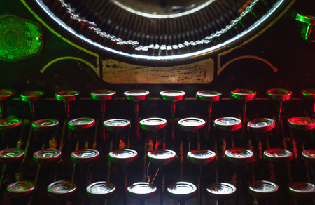 typewrite: Details of an old typewriting machine, retro style with dusty metal and buttons. Stock Photo
