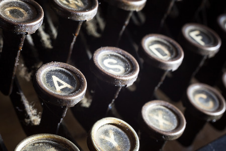Details of an old retro typewriter, vintage style, dusty surfaces. photo