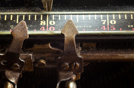 ides: Part of an old typewriter, closeup of part for measuring.