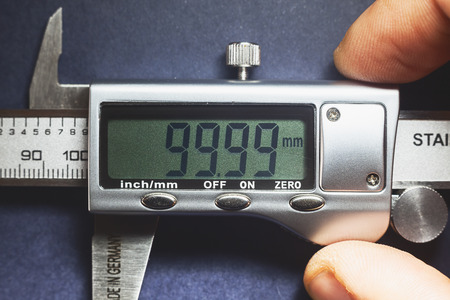 precise: Details of modern measuring tool, digital display showing precise dimension in two decimals. Stock Photo