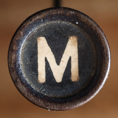 key words: Details of a dusty old letter, closeup of vintage typewriter.