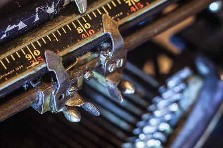 metering: Details of an old typewriter, metering of paper position.