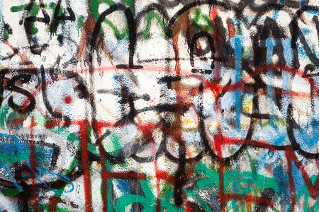 chaotic: Graffiti as a wall texture, colorful and chaotic. Stock Photo