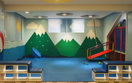 kindergarten toys: Modern kindergarten interior, details of toys and equipment, colorful room design.