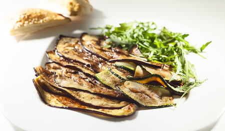 oiled: Details of grilled eggplant, served on white plate. Stock Photo