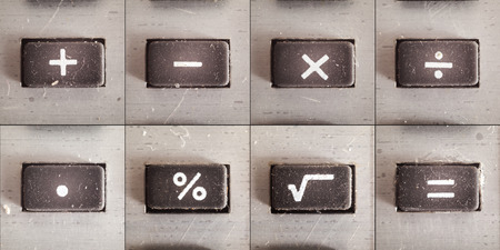 multiplying: Set of basic math operations, buttons from an old calculator.