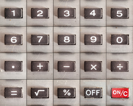 multiplying: All buttons from an old calculator, numbers and math operations, on and off. Complete set. Stock Photo
