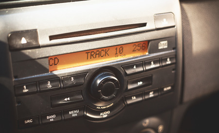 radio unit: Radio and CD player, details of a car interior. Stock Photo