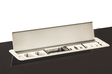 built in: Modern electric plugs built in table, clever solutions for saving space, and making cords invisible. Stock Photo
