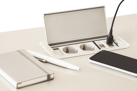 turn off: Modern electric plugs built in table, clever solutions for saving space, and making cords invisible. Stock Photo