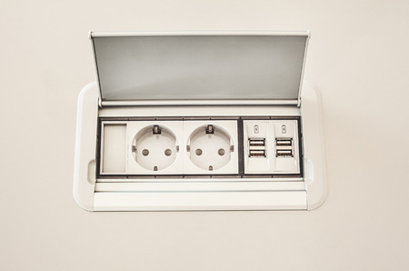 electric plug: Modern electric plugs built in table clever solutions for saving space and making cords invisible.