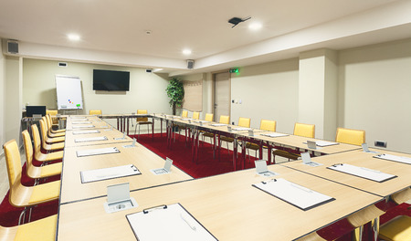 Interior of a modern conference room tables with built in power supply. Standard-Bild