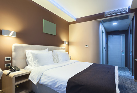 Interior of a hotel room for two persons. Modern luxury design. Standard-Bild