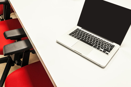 furniture hardware: Modern laptop on white table, details of an office interior. Stock Photo