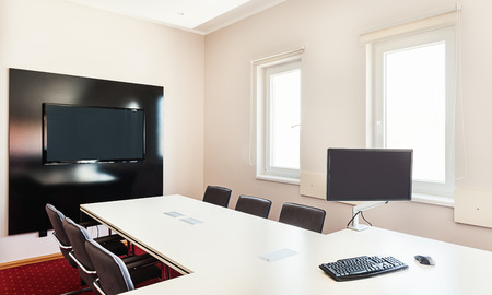 furniture hardware: Interior of a modern office, furniture in white and computer hardware on table.