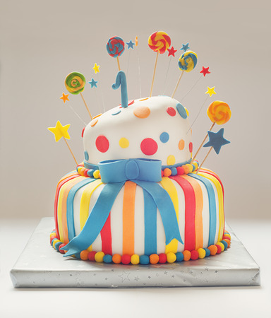 Funny birthday cake with number one on top sweet colorful decoration.