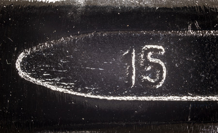 molted: Molten number on metal surface, dusty and dirty surface details. Stock Photo