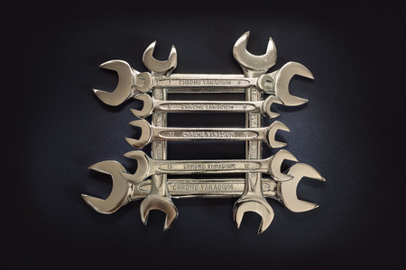 chrome vanadium: Set of wrenches in square order, simple composition with accentuated center of the image.