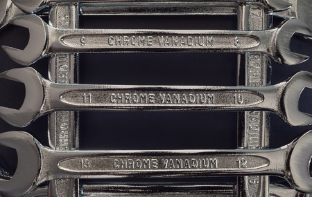 chrome vanadium: Various sizes of metal wrenches, abstract details of a set.