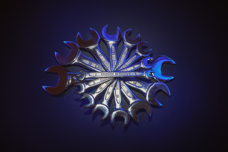 alloys: Interesting composition made of wrenches, accentuated center part with title in the middle.