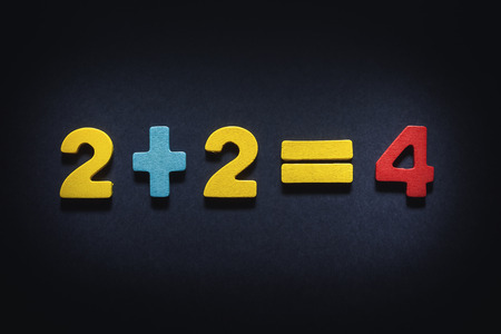 illustrates: Two plus two equal four, concept composition illustrates fairness. Stock Photo