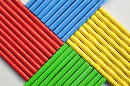 vibrant colors: Abstract composition of wooden sticks in various vibrant colors.