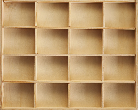 divided: Details and textures of a wooden container, sixteen square partitions.
