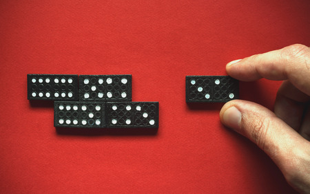 Illustration of next move in domino game simple composition on red background.