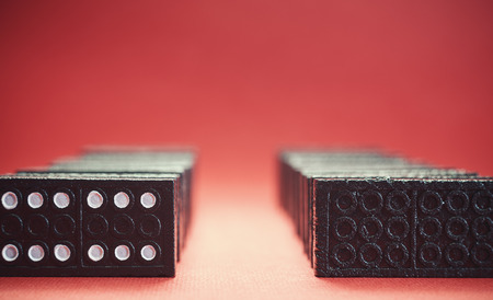 row: Two rows of dominoes background in blur and red. Stock Photo