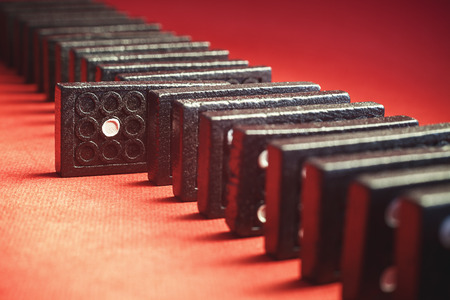 chosen one: Conceptual composition of dominoes with chosen one of them with number one red background in blur. Stock Photo
