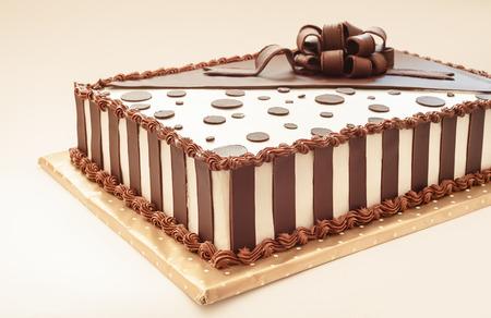 Chocolate cake on white background, decoration details.