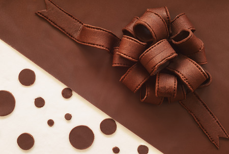 One ornament from chocolate cake, chocolate ribbon details, areal view.