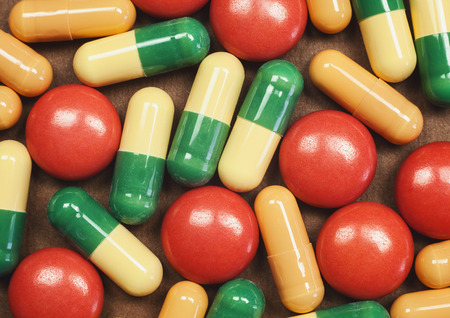diagnoses: Macro view on pills and tablets, abstract composition, textures details.