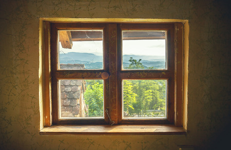 windows frame: Interior details of an old retro house, window closeup with view on countryside. Stock Photo