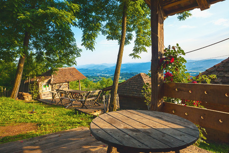 during the day: Old wooden retro household, details of a garden with fantastic view on nature, summer season during day time.