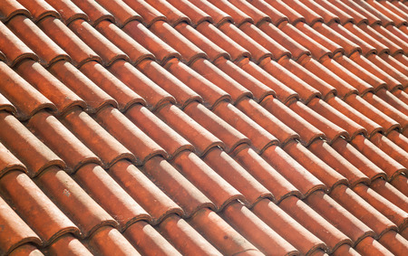 top: Details of not so old roof tiles, view from aside. Stock Photo