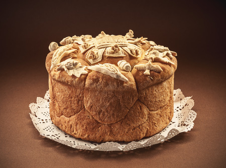 culture: Decorated bread for celebration a saint in Orthodox faith. Serbian traditional and cultural heritage. Stock Photo