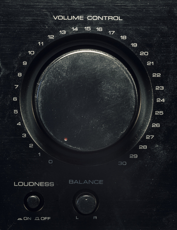 loudness: Details of an old amplifier, closeup view on volume control, balance and loudness. Stock Photo