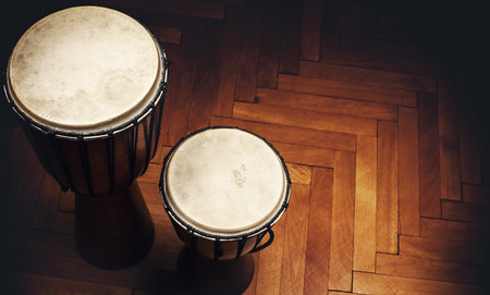 percussion: Two old vintage style wooden djembes, percussion instruments from Balkan and Africa.