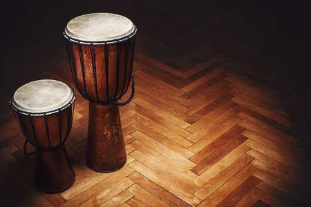 djembe drum: Two old vintage style wooden djembes, percussion instruments from Balkan and Africa.