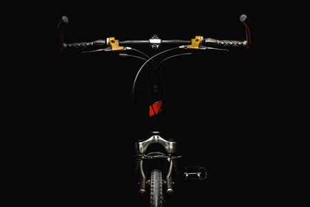 handlebars: Part of a modern sport bicycle, accentuated shapes with illumination.