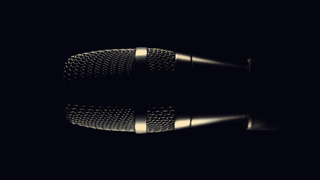 Black modern microphone on stand, black dark background. Accentuated shapes with light. Stock Photo