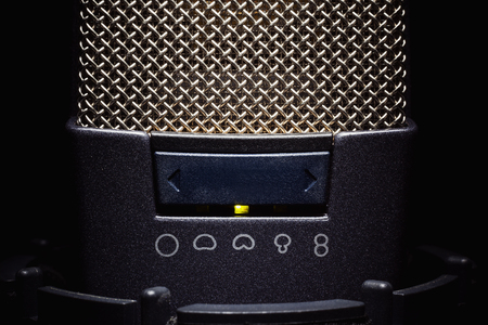 frequencies: Head details of a microphone, switchers for various frequencies and volume.
