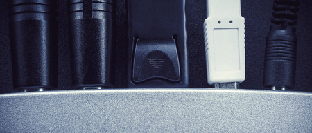plugins: Part of a musical equipment, cables and plugs details. Stock Photo