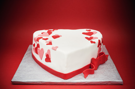 Details of a cake in shape of heart.