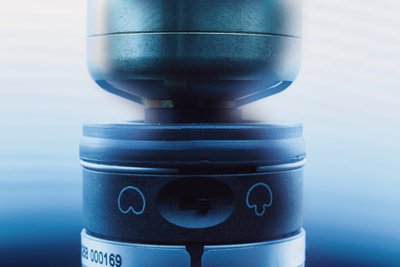 cardioid: Closeup view of a modern microphone, highlighted parts by illumination.