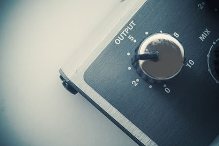 guitar amplifier: Details of an old guitar pedal, closeup view of output and volume button. Stock Photo